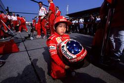 A young fan of Michael Schumacher, Ferrari with the helmet
