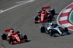 Kimi Raikkonen, Ferrari SF71H and Valtteri Bottas, Mercedes-AMG F1 W09 EQ Power+ battle and Sebastian Vettel, Ferrari SF71H
