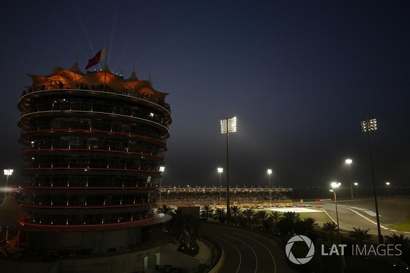 Sebastian Vettel, Ferrari SF71H, leads Valtteri Bottas, Mercedes AMG F1 W09, Kimi Raikkonen, Ferrari