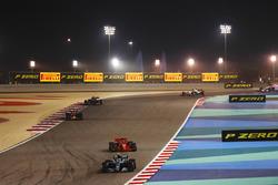Valtteri Bottas, Mercedes AMG F1 W09, leads Kimi Raikkonen, Ferrari SF71H, and Daniel Ricciardo, Red Bull Racing RB14 Tag Heuer, and the remainder of the field