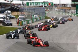 Sebastian Vettel, Ferrari SF71H, leads Max Verstappen, Red Bull Racing RB14, Valtteri Bottas, Mercedes AMG F1 W09, Lewis Hamilton, Mercedes AMG F1 W09, Kimi Raikkonen, Ferrari SF71H, Daniel Ricciardo, Red Bull Racing RB14, and the rest of the field at the start of the race
