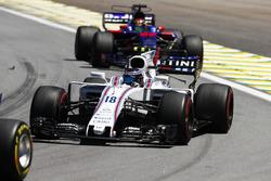 Лэнс Стролл, Williams FW40, и Брендон Хартли, Scuderia Toro Rosso STR12