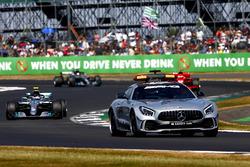 The Safety Car leads Valtteri Bottas, Mercedes AMG F1 W09
