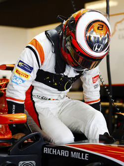 Stoffel Vandoorne, McLaren, enters his cockpit