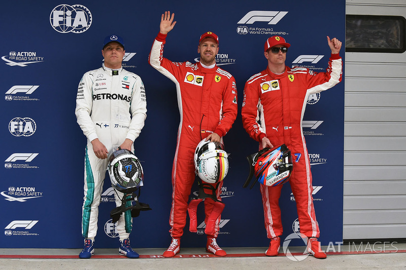 Tiga besar kualifikasi: Sebastian Vettel, Ferrari, Kimi Raikkonen, Ferrari, Valtteri Bottas, Mercedes AMG F1