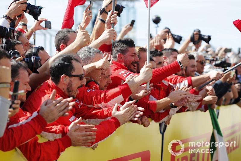 The Ferrari team cheer as Kimi Raikkonen, Ferrari SF71H, 1st position, arrives in Parc Ferme