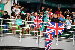 Fans and flags in the grandstand