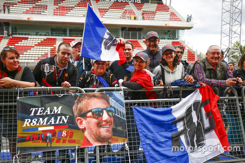 Fans of Romain Grosjean, Haas F1 Team, queue for an autograph