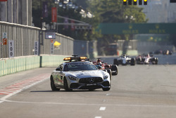 The Safety Car leads Lewis Hamilton, Mercedes AMG F1 W08, the rest of the field