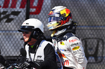 Daniel Ricciardo, Red Bull Racing on the back of a motorbike after retiring