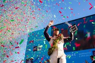 Confetti falls as Sam Bird, Envision Virgin Racing, 3rd position, celebrates on the podium