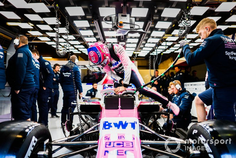 Lance Stroll, Racing Point RP19, getting into the car in the garage