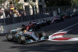 Lewis Hamilton, Mercedes AMG F1 F1 W08  leads Sebastian Vettel, Ferrari SF70H at the restart
