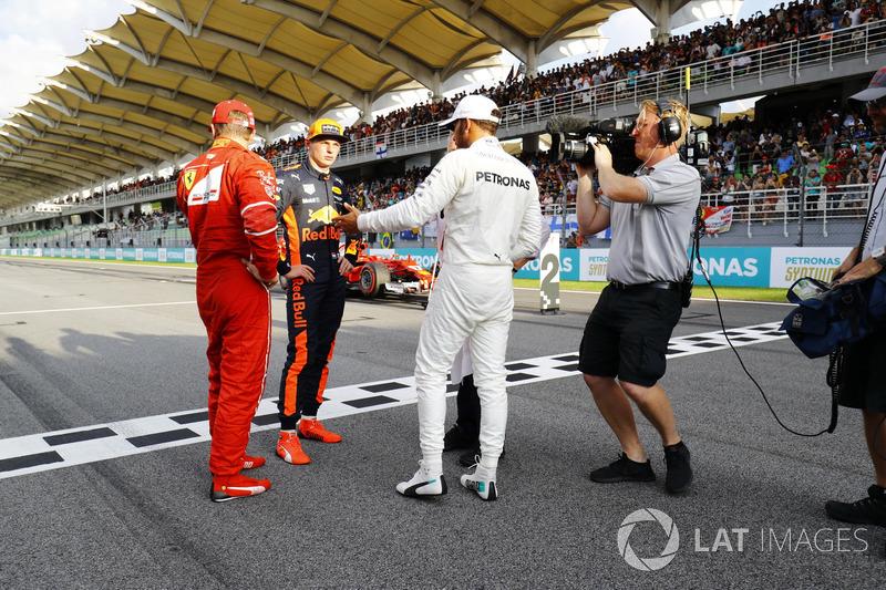The top-three qualifiers Kimi Raikkonen, Ferrari, Max Verstappen, Red Bull Racing and pole winner Lewis Hamilton, Mercedes AMG F1