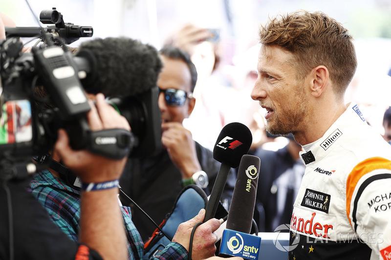 Jenson Button, McLaren, is interviewed