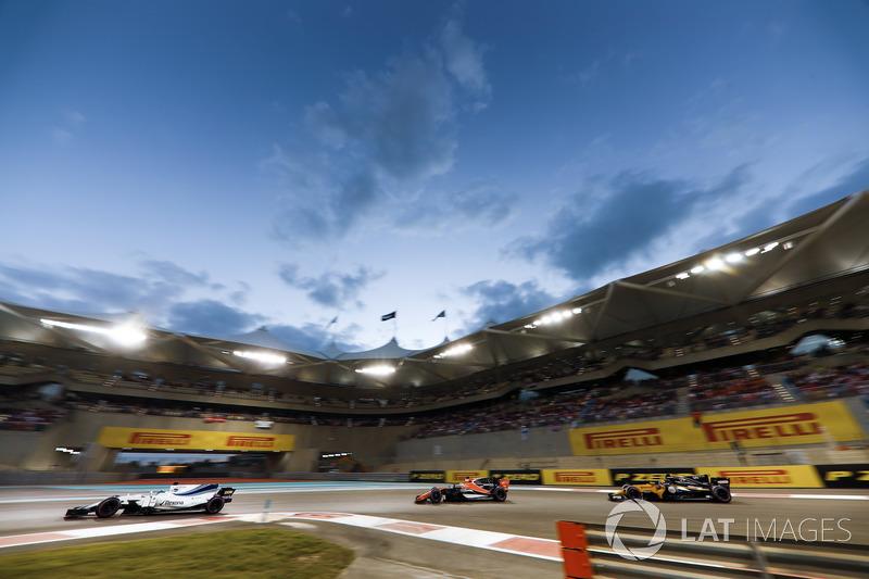 Felipe Massa, Williams FW40 leads Fernando Alonso, McLaren MCL32 and Carlos Sainz Jr., Renault Sport
