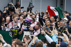 Sergio Perez, Force India, celebrates with his team after the race