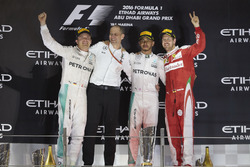 Podium: second place  and new World Champion Nico Rosberg, Mercedes AMG, Tony Ross, Race Engineer, Mercedes AMG, Race winner Lewis Hamilton, Mercedes AMG, third place Sebastian Vettel, Ferrari