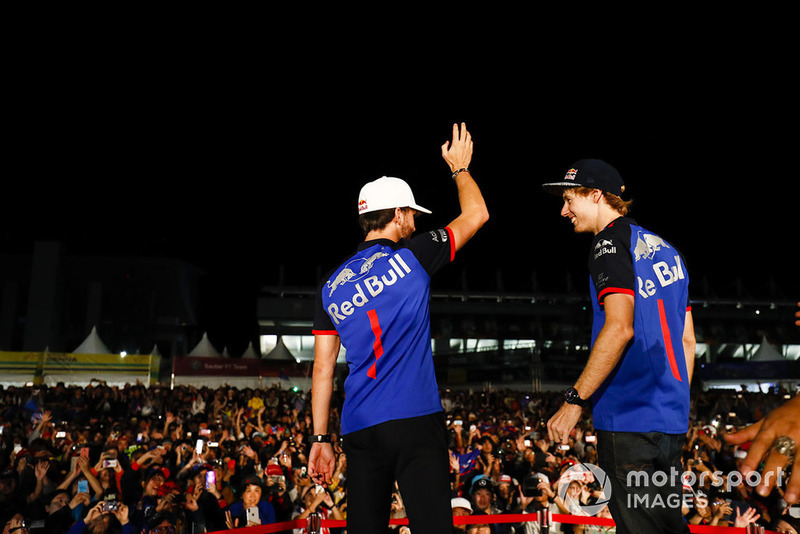 Pierre Gasly, Scuderia Toro Rosso, and Brendon Hartley, Scuderia Toro Rosso, wave to fans