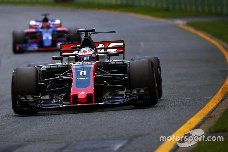 Romain Grosjean, Haas F1 Team, VF-17; Daniil Kvyat, Scuderia Toro Rosso, STR12