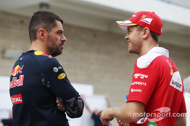 (L to R): Guillaume Rocquelin, Red Bull Racing Head of Race Engineering with Sebastian Vettel, Ferrari
