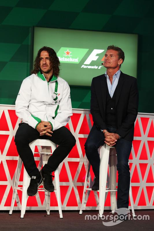 Carles Puyol, ex jugador de fútbol y David Coulthard, Red Bull Racing y Scuderia Toro asesor / canal 4 comentarista de F1, en un anuncio de patrocinio de Heineken