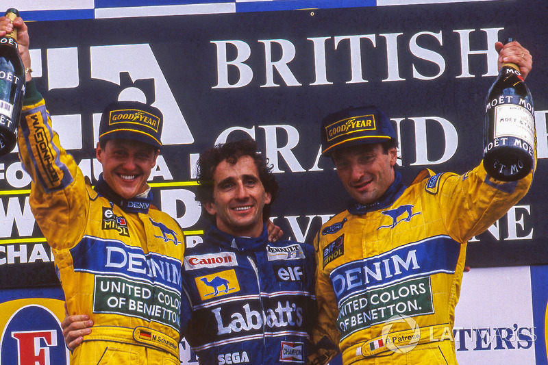 Podium: race winner Alain Prost, second place Michael Schumacher, third place Ricardo Patrese