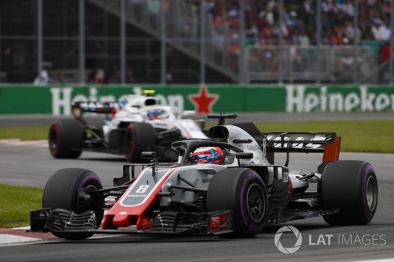 Romain Grosjean, Haas F1 Team VF-18, leads Sergey Sirotkin, Williams FW41