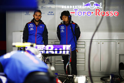 Toro Rosso and Honda team members in the team's garage