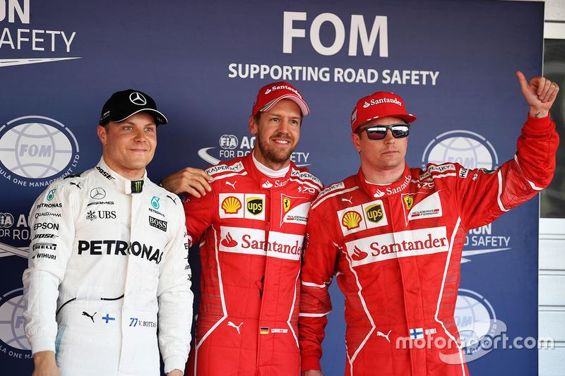 Polesitter Sebastian Vettel, Ferrari, second place Kimi Raikkonen, Ferrari, third place Valtteri Bottas, Mercedes AMG F1