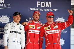 Ganador de la pole Sebastian Vettel, Ferrari, segundo Kimi Raikkonen, Ferrari, tercero Valtteri Bottas, Mercedes AMG F1
