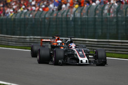 Romain Grosjean, Haas F1 Team VF-17, pulls ahead of Fernando Alonso, McLaren MCL32