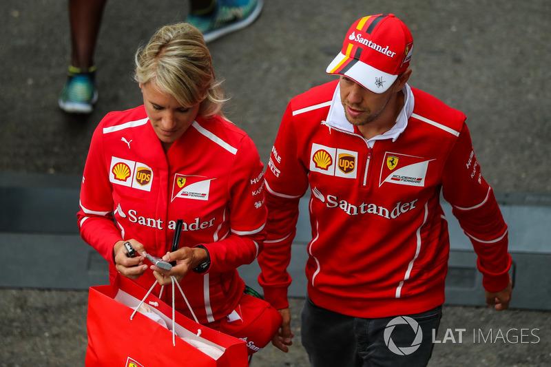 Sebastian Vettel, Ferrari, with Britta Roeske, in parc ferme