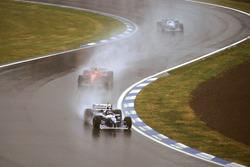 Jacques Villeneuve, Williams FW18 Renault with Michael Schumacher, Ferrari F310 and Jean Alesi, Benetton B196 Renault