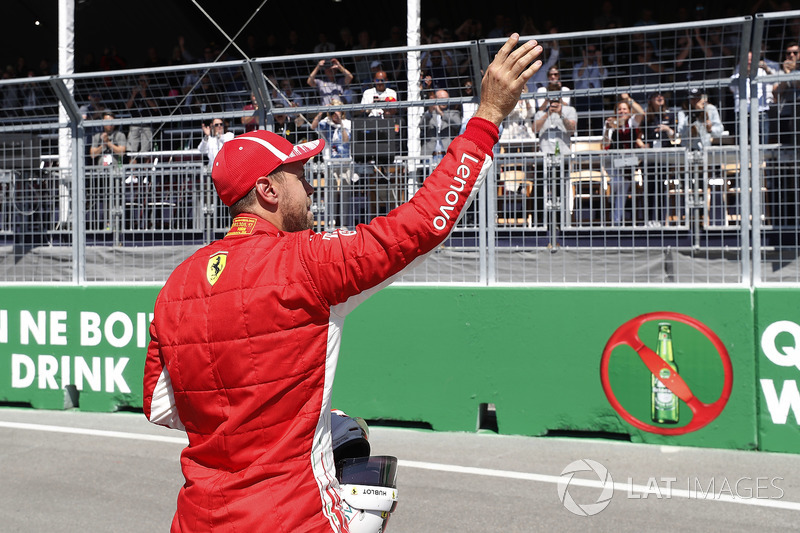 Pole man Sebastian Vettel, Ferrari, celebrates after Qualifying