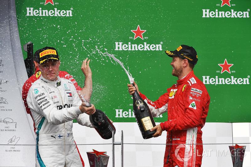 Valtteri Bottas, Mercedes-AMG F1 and Sebastian Vettel, Ferrari celebrate on the podium with the cham