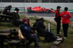 Fans watch Sebastian Vettel, Ferrari SF71H