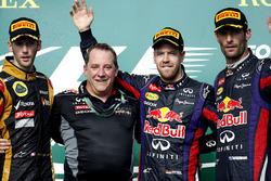 Podium: second place Romain Grosjean, Lotus F1, Matt Cadieux, Chief Information Officer, Red Bull Racing, Race winner Sebastian Vettel, Red Bull Racing, third place Mark Webber, Red Bull Racing