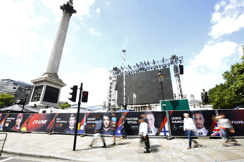 Banners for drivers including Max Verstappen, Red Bull, Daniel Ricciardo, Red Bull Racing, Valtteri Bottas, Mercedes AMG F1, Lewis Hamilton, Mercedes AMG F1, at the base of Nelsons Column