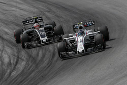 Lance Stroll, Williams FW40 and Kevin Magnussen, Haas F1 Team VF-17