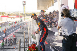 Third place Daniel Ricciardo, Red Bull Racing, sprays champagne on the podium