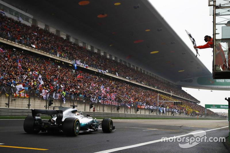 Lewis Hamilton, Mercedes AMG F1 W08, takes the chequered flag
