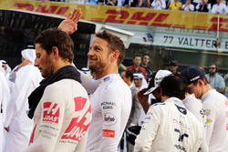 Jenson Button, McLaren as the grid observes the national anthem