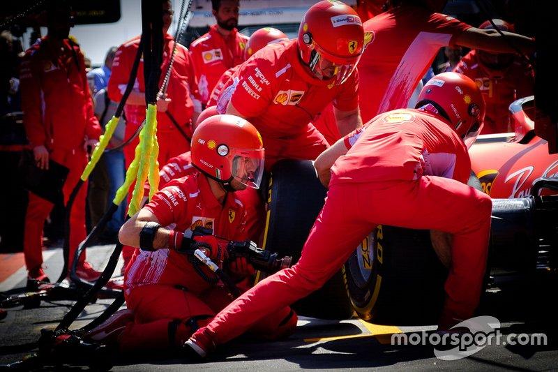 Ferrari team members practice pitstop