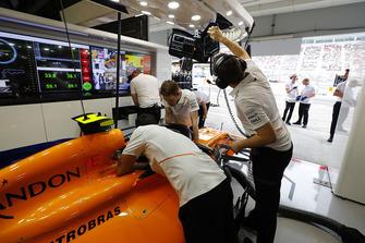 Team members work on the car of Stoffel Vandoorne, McLaren MCL33