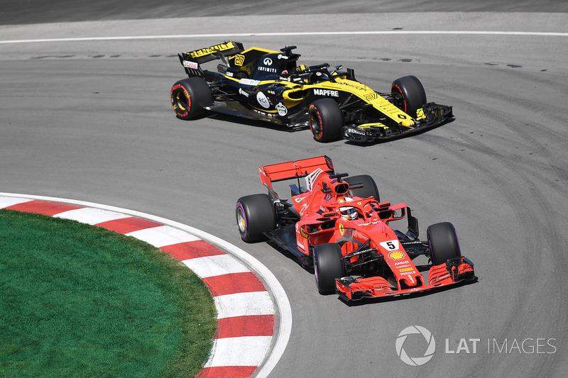 Sebastian Vettel, Ferrari SF71H and Nico Hulkenberg, Renault Sport F1 Team R.S. 18