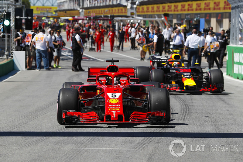 Sebastian Vettel, Ferrari SF71H, celebrates pole position ahead of Max Verstappen, Red Bull Racing