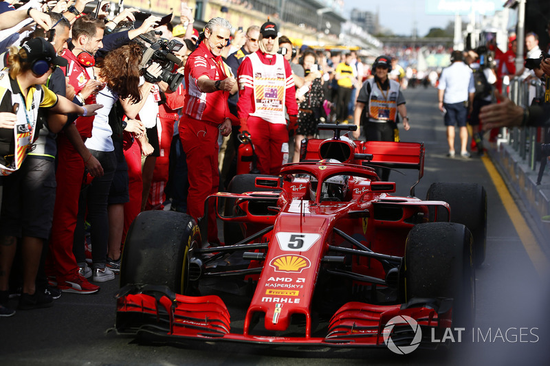 Sebastian Vettel, Ferrari SF71H, 1st position, passes Maurizio Arrivabene, Team Principal, Ferrari, as he brings his car in to Parc Ferme
