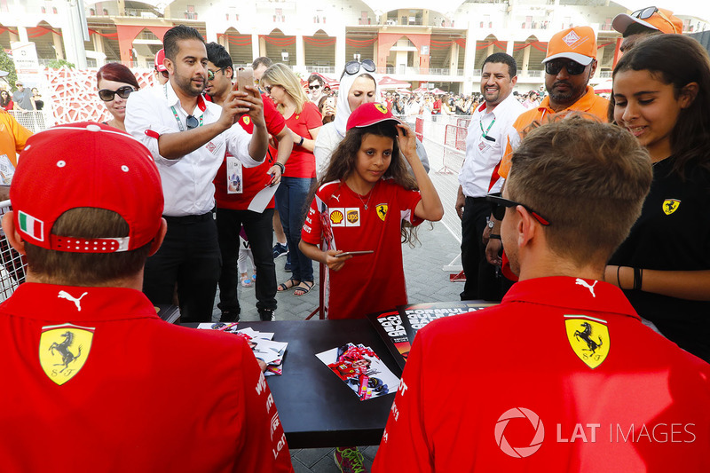 Sebastian Vettel, Ferrari, and Kimi Raikkonen, Ferrari, sign autographs for fans
