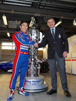 Indy 500 winner Takuma Sato, Andretti Autosport with the Borg-Warner Trophy and Scott Gallett, VP of marketing at BorgWarner Inc.